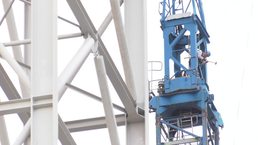 Poland / Silesia - June 2018: The huge crane works during the construction of the Tauron power plant in Jaworzno. 4K, UHD Panning  | Shutterstock HD Video #1012438313