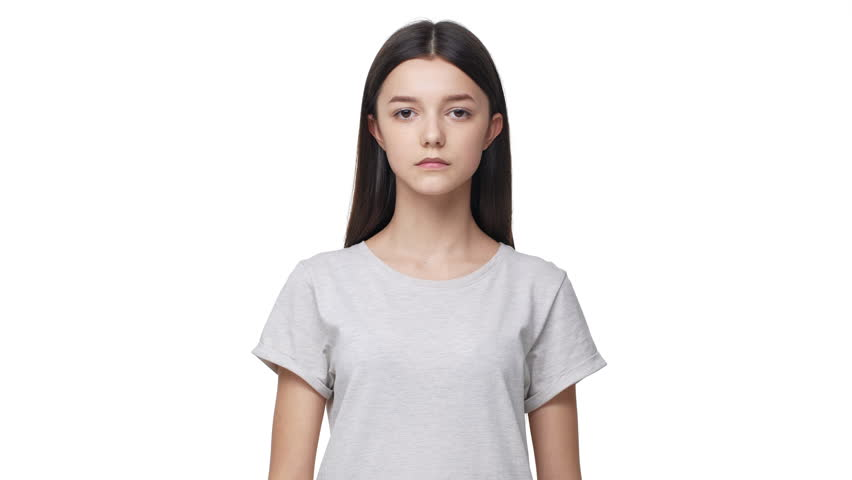 Portrait of concentrated brunette woman touching chin thinking about important things and doubting or trying to remember, isolated over white background. Concept of emotions