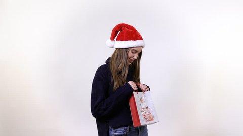 Girl unpacking a gift bag