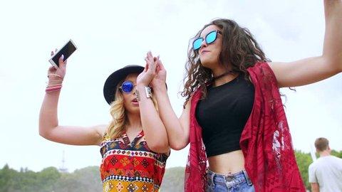 Young women dancing outside