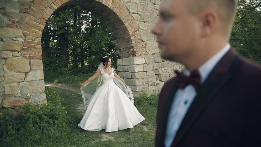 Beautiful and lovely bride dancing near handsome groom | Shutterstock HD Video #1012519013