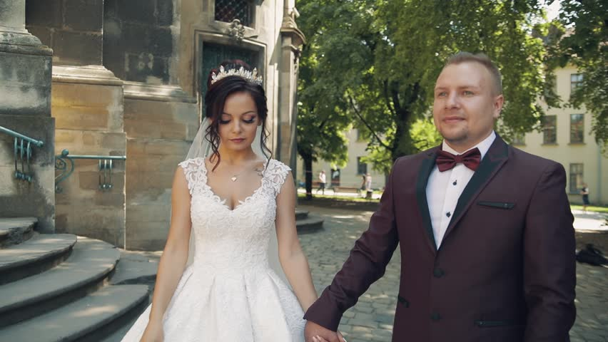Lovely wedding couple walking together in the city | Shutterstock HD Video #1012519043
