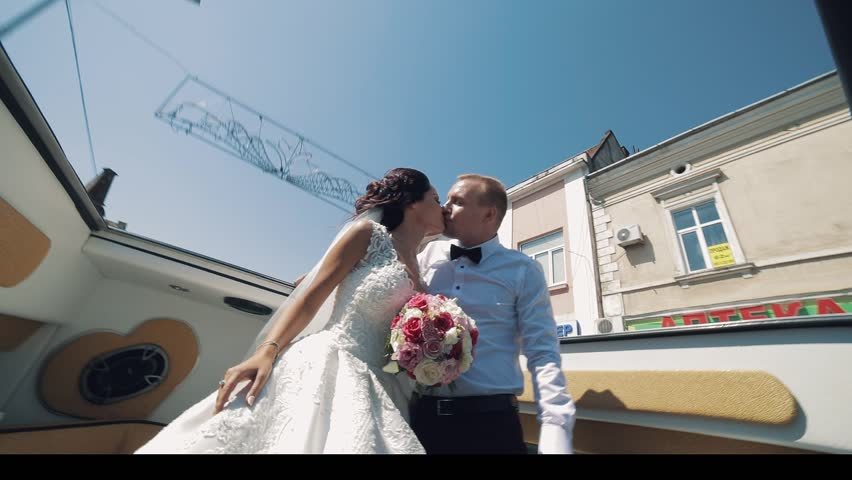 Lovely wedding couple ride with open car roof | Shutterstock HD Video #1012519103