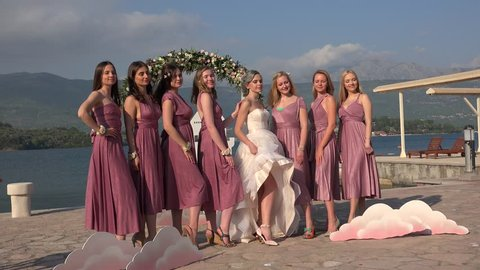 KOTOR BAY, - APRIL 23: Bridesmaids & bride are posing for a photoshoot in the Kotor bay. Aprilr 23, 2018 in Kotor bay, Montenegro