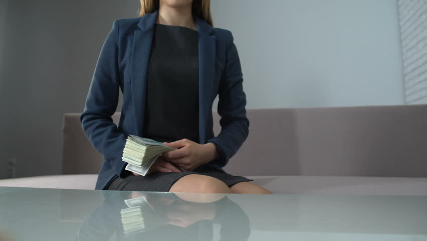 Successful business woman paying money for office rent, real estate market deal | Shutterstock HD Video #1012573373