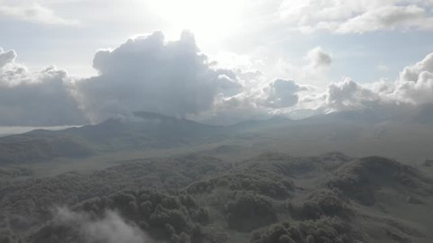flight above clouds in mountain