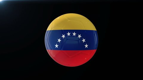 Football with flag of Venezuela, soccer ball with Venezuelan flag, sports equipment rotating on black background, 3D animation