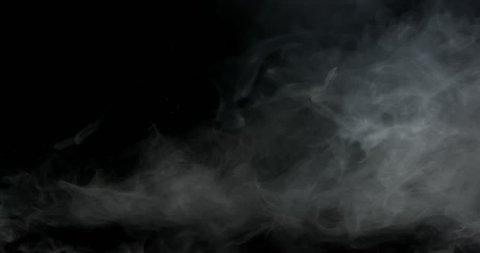 Wispy smoke hanging in frame spooky atmospheric effect