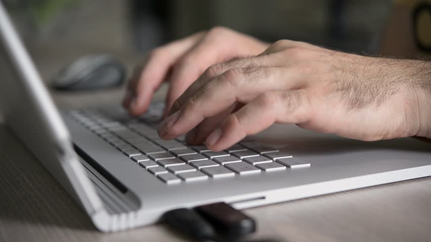 Closeup of hands working and typing on laptop keyboard on table | Shutterstock HD Video #1012711283
