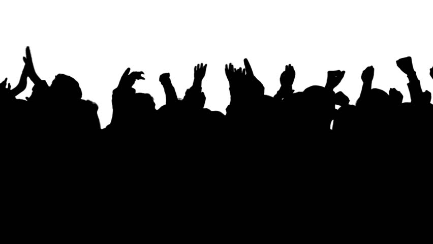A cheering crowd in silhouette at a concert, rally or sporting event.