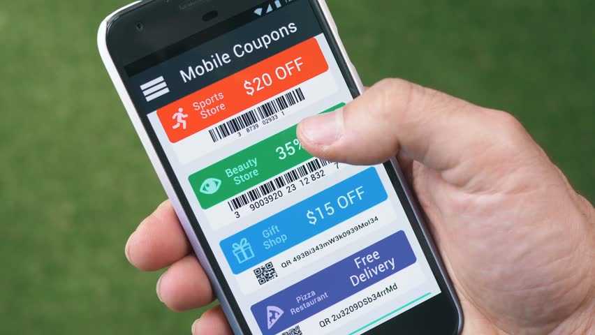 Browsing many discount coupons on a smartphone. Showing different QR code and Bar code coupons to save money online.