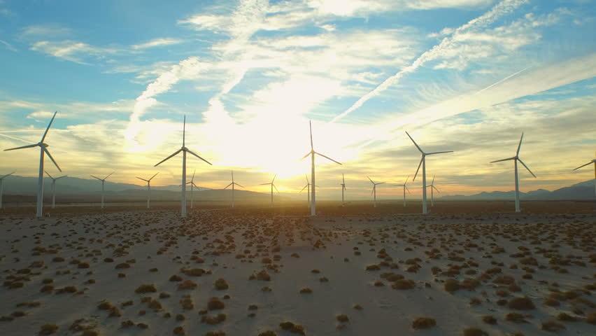 Wind Turbine Aerial v7 Flying low below large wind turbines at sunrise. | Shutterstock HD Video #10128188
