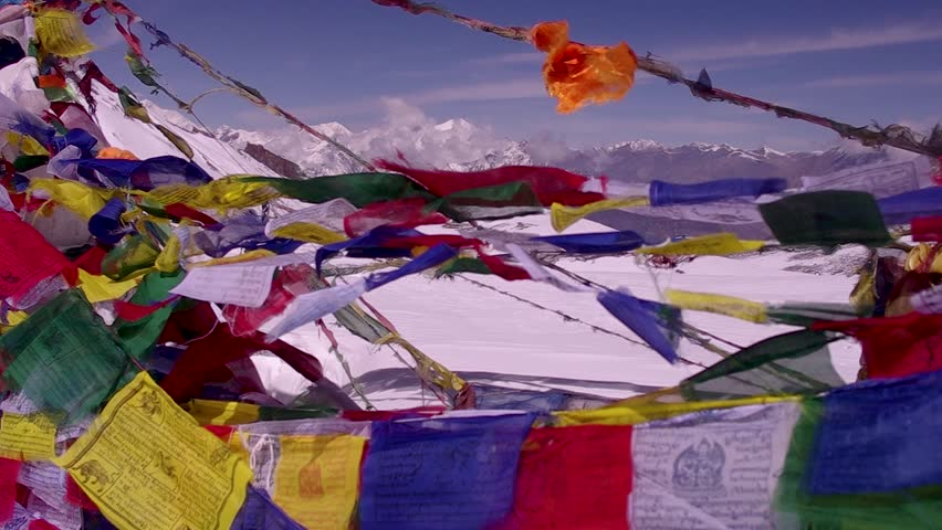 Prayer Flags blowing in the wind on Nepal Mountain Pass