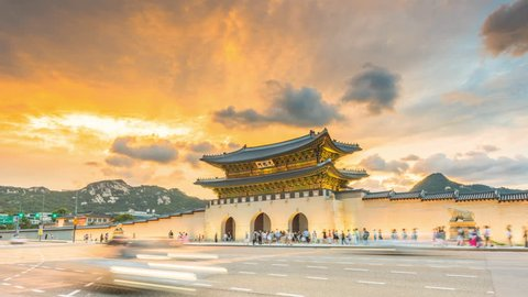Gyeongbokgung Palace At Twilight Sunset In South Korea, with the name of the palace Gyeongbokgung' on a sign