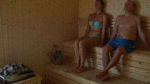 Couple sitting in the sauna at the Chamber and speaks