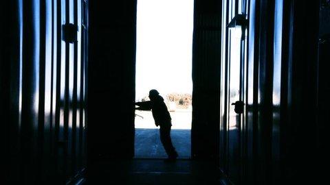 Warehouse Worker Opening Metal Door. Blue Steel Tone. Zoom In.