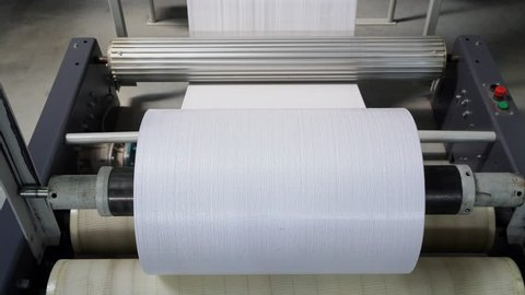 The resulting polypropylene sleeve for the manufacture of bags is wound on  large reels  drum for winding sleeves of woven polypropylene yarns  pp bag  production line