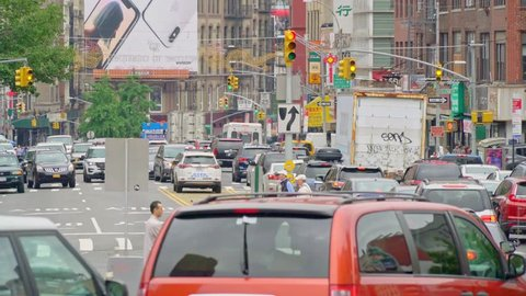 New York, United States, June 10, 2018: traffic exiting the Manhatten bridge into Chinatown in Downtown New York city