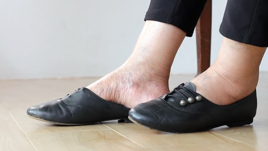 9e8e97140572 Elderly Woman Swollen Feet Putting Stock Footage Video (100% Royalty-free)  1013049683 | Shutterstock