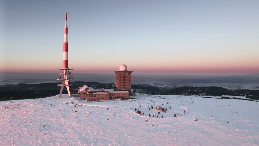 Aerial view of the Brocken peak in the Harz mountains in winter during sunset | Shutterstock HD Video #1013093153
