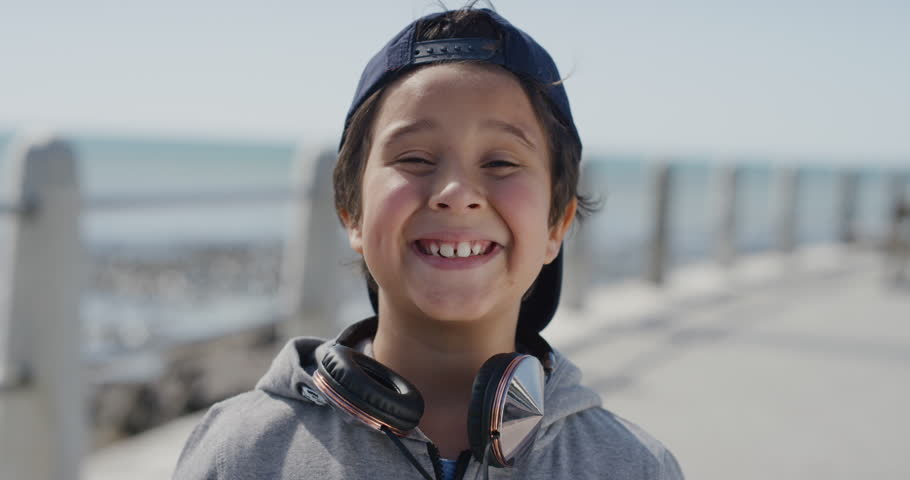 Portrait young little boy smiling cheerful enjoying summer vacation day on warm seaside beach real people series | Shutterstock HD Video #1013096573