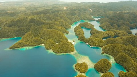 Aerial view: Bucas Grande Island, Sohoton Cove. Philippines. Tropical sea bay and lagoon, beach. Tropical landscape hill, clouds and mountains rocks with rainforest. Azure water of lagoon. Shore