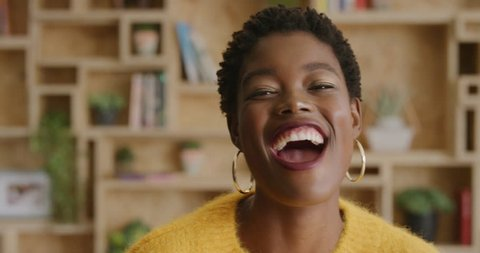close up portrait of attractive african american business woman laughing cheerful enjoying lifestyle successful black female wearing stylish fashion real people series