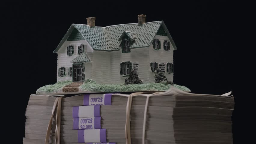 House on top of a large stack of money bills. Real estate mortgage concept shot. | Shutterstock HD Video #1013155343