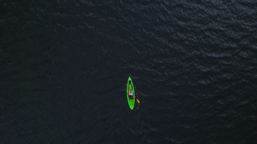 Aerial Flight Over Man Paddling Canoe In Nature Reserve Isolation Nature Vacation Difficulty Concept