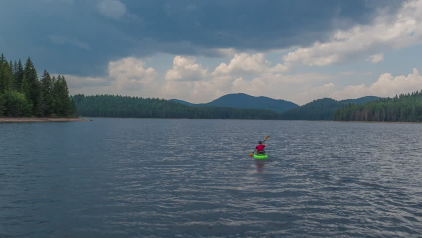 Aerial Flight Over Lonely Man On Canoe At Beautiful Lake Isolation Nature Vacation Difficulty
