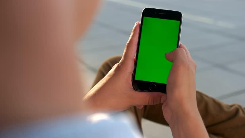 Man hands using smart phone with green screen | Shutterstock HD Video #1013198063