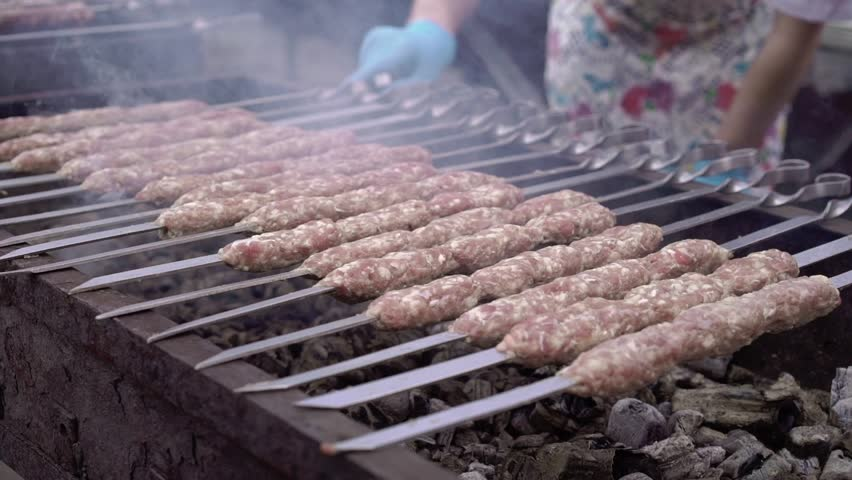 Cooking meat at barbeque grill outdoors | Shutterstock HD Video #1013228783