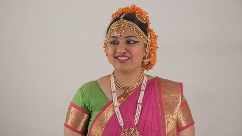 Indian girl showing different moods using traditional Bharat Natyam dance form. Surprise expression.