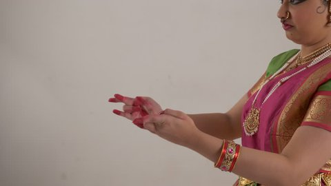 Indian girl performing traditional Bharat Natyam showing hand postures.
