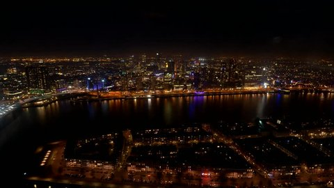 Timelapse video of Rotterdam at night with rushing traffic, ships, the river Maas and all the city lights