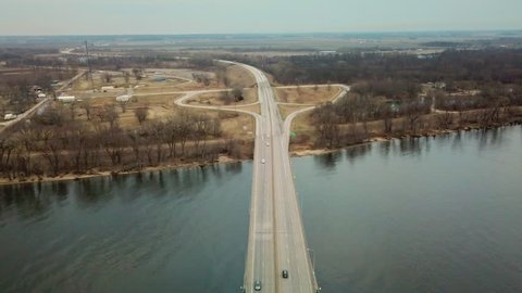 BURLINGTON, IOWA - CIRCA 2017 - Aerial of a suspension bridge crossing the Mississippi River near Burlington, Iowa suggests American infrastructure.