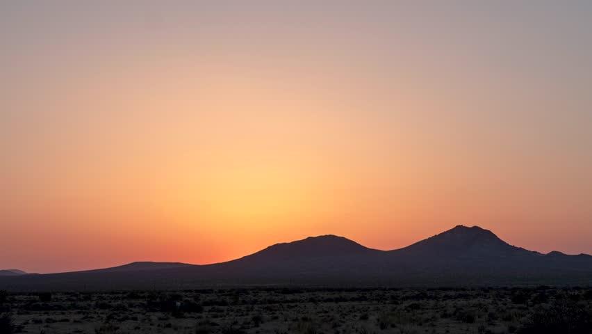 Time Lapse of a beautiful sunrise over a mountain desert landscape