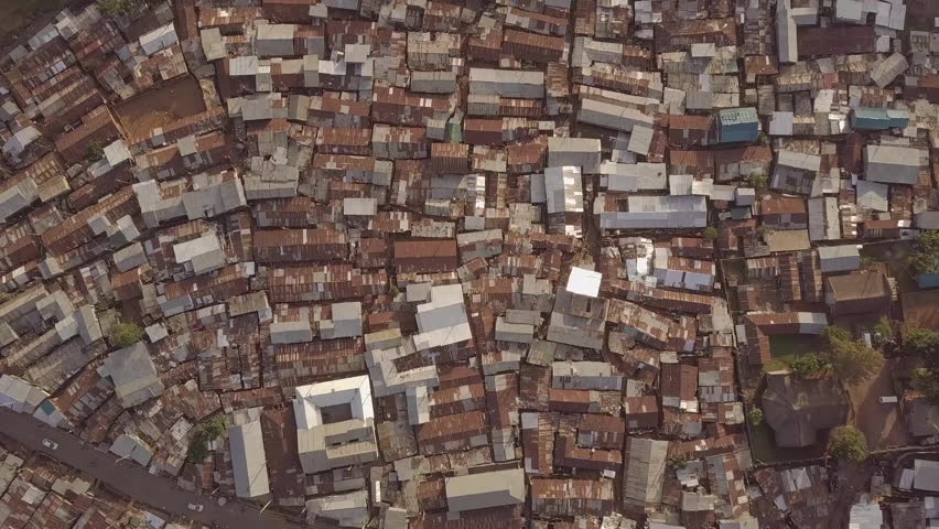 KIBERA, NAIROBI, KENYA, AFRICA - CIRCA 2017 - Aerial shot looking straight down above vast overpopulated slums in Kibera, Nairobi, Kenya, Africa.