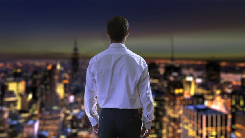 Businessman viewing night city from skyscraper, raising hands in victory success #1013421503