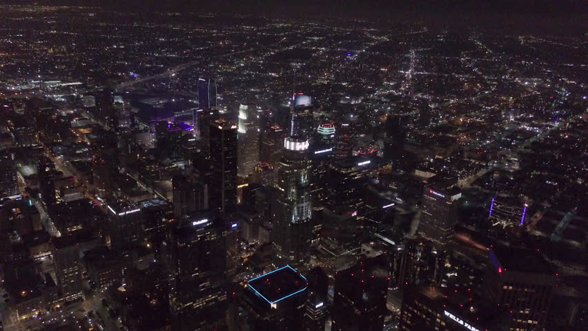 The following is Aerial footage of downtown LA high in the sky from a helicopter. This footage was taken on a gopro.   Shutterstock HD Video #1013460053