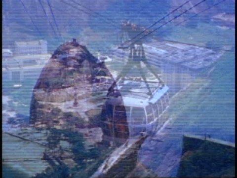 BRAZIL, 1982, Rio de Janeiro, Sugar Loaf, cable car up, zoom wide to Copacabana