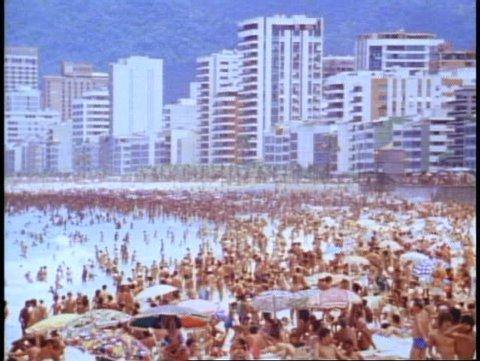 BRAZIL, 1982, Rio de Janeiro, Copacabana beach, crowded, hotels in background