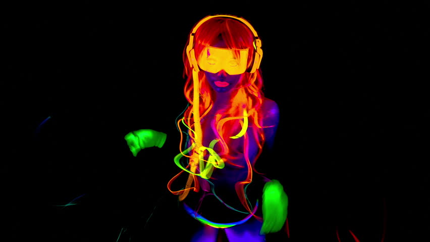 fantastic video of sexy cyber raver dancer babe filmed in fluorescent clothing under UV black light