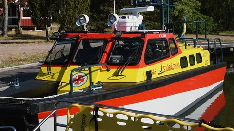 Okno, Monsteras, Sweden - June 28, 2018: Everyday scene of a search and rescue boat moored in a marina. Detail of the cockpit and side exterior.