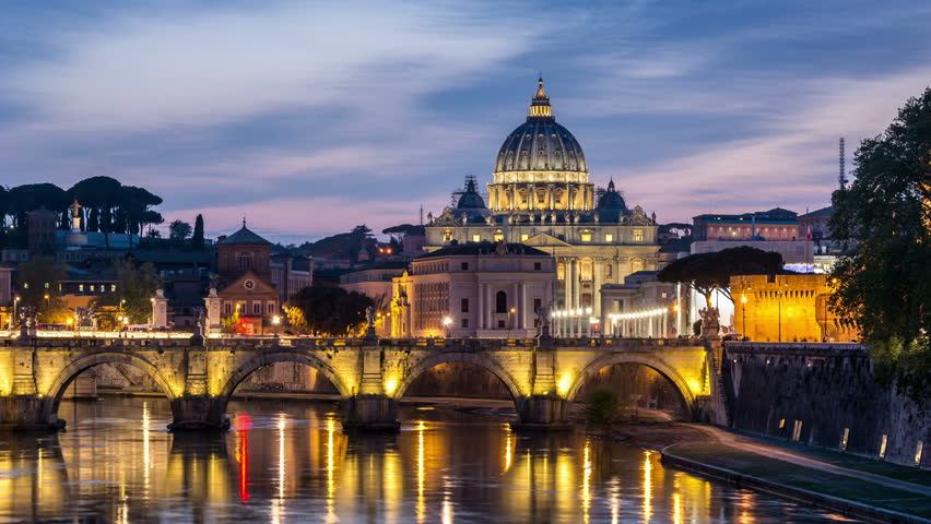 The Sant'Angelo bridge over the Tiber river. The St. Peter's Basilica is in the background. Day to night time lapse video.