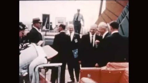 CIRCA 1960s - President Dwight D. Eisenhower travels in a motorcade and then he boards the Columbine II aircraft.