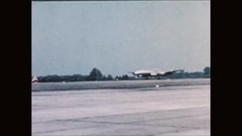 CIRCA 1960s - The Columbine II aircraft lands and President Dwight Eisenhower deplanes.