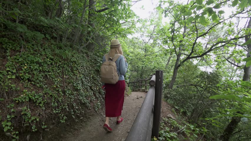 Young Female Traveler Walking at Igidae Coastal Walk in Busan City, South Korea. Active Tourism Concept #1013540603