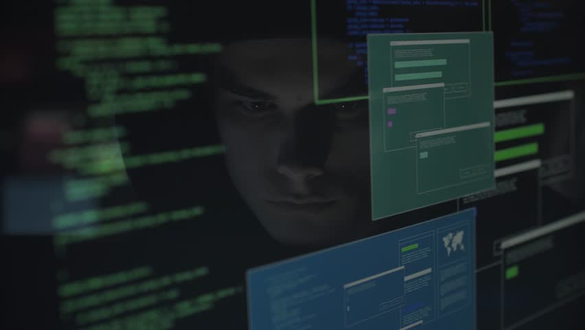 Young hacker with hoodie connecting with his computer and committing cyber crimes, hacking and malware concept, video montage | Shutterstock HD Video #1013580533