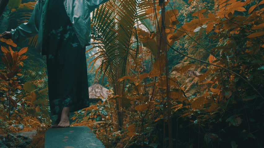 Beautiful fashion girl posing in tropical rain forest jungle near the waterfall. Portrait of stylish hipster female outdoor | Shutterstock HD Video #1013600513